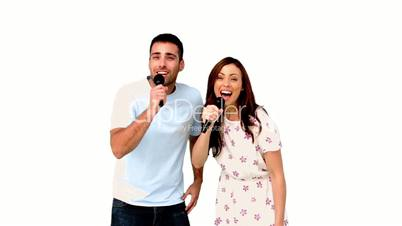 Friends dancing and singing on white background