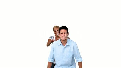 Smiling man giving to his girlfriend a piggyback