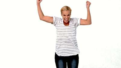 Blonde woman jumping against white background