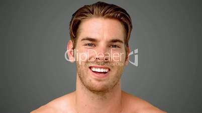 Man showing his happiness on grey background