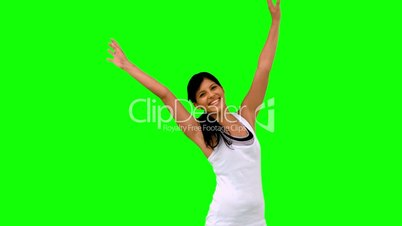 Woman in sportswear stretching her arms on green screen