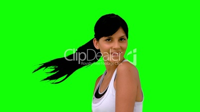 Athletic woman tossing her hair on green screen