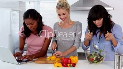 Friends following an online recipe