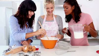 Three friends home baking together