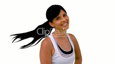 Fit woman tossing her hair and smiling