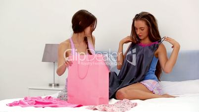 Girls looking at their shopping purchases
