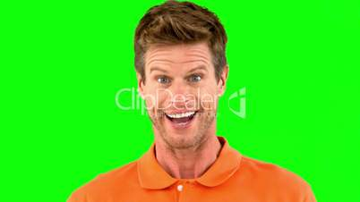 Handsome man saying yes with his head on green screen