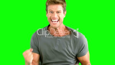Attractive man gesturing and showing his happiness on green screen