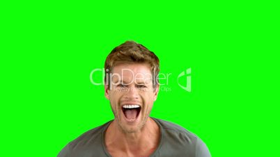 Handsome man laughing on green screen