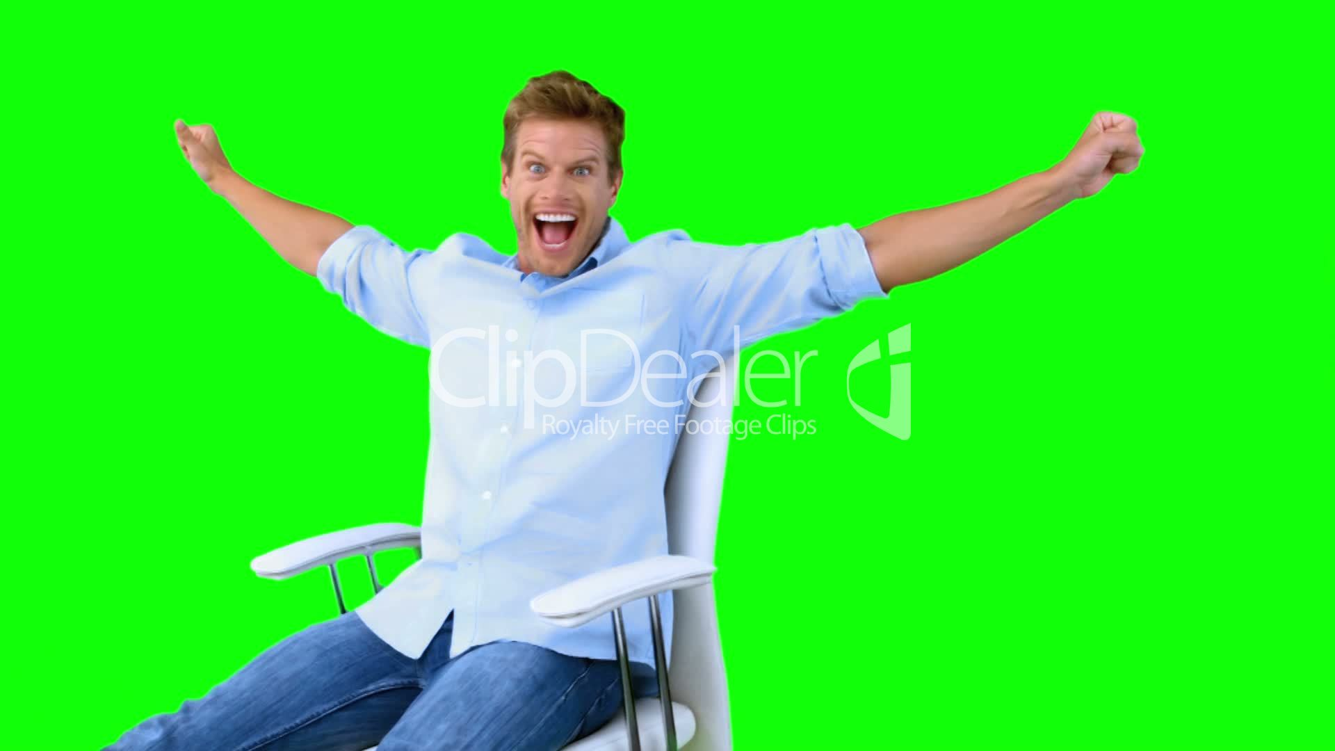 Man Sitting On Swivel Chair With Raised Arms To Show His