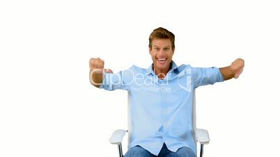 Man on swivel chair giving thumbs up on white screen