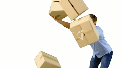 Clumsy man dropping boxes down on white screen