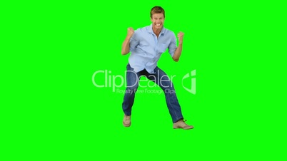 Man jumping to show his triumph on green screen