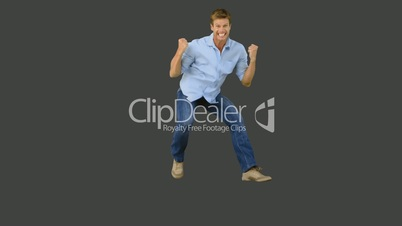 Man jumping to show his triumph on grey screen