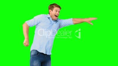 Smiling man jumping on green screen