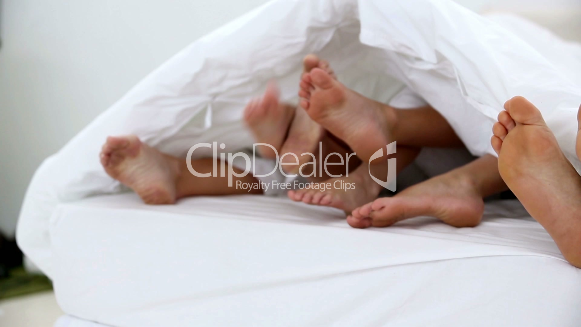 Family Kicking Their Feet Under The Covers Royalty Free Video And Stock Footage
