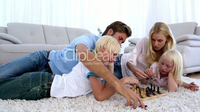 Family playing chess together