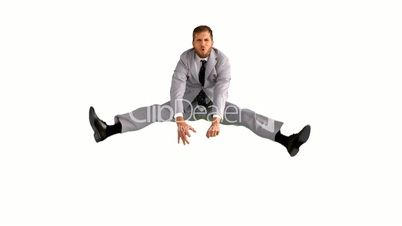 Businessman jumping and doing the splits
