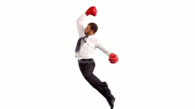 Businessman in boxing gloves jumping and punching air