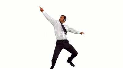 Businessman jumping up and dancing while listening to music