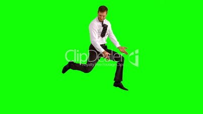 Businessman jumping up for joy