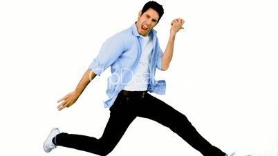 Man playing air guitar on white background