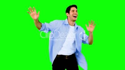 Man dancing and having fun on green screen