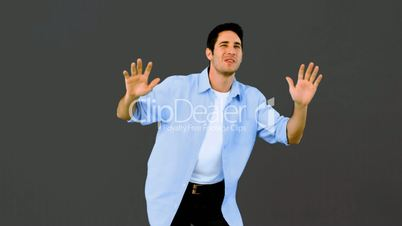 Man dancing and having fun on grey background