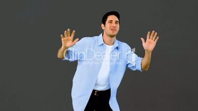 Man dancing and having fun on grey background