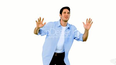 Man dancing and having fun on white background