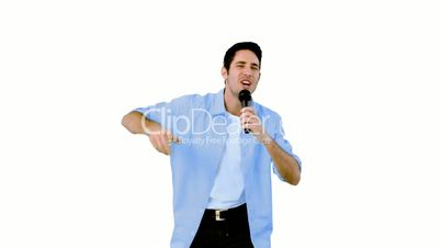 Man singing into microphone on white background