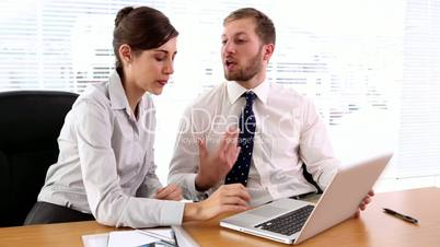 Business people working together on the laptop