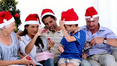 Family swapping gifts at christmas