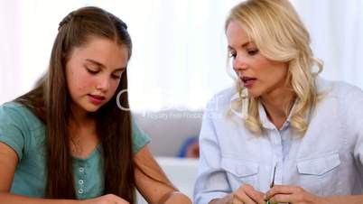 Mother and daughter doing art together
