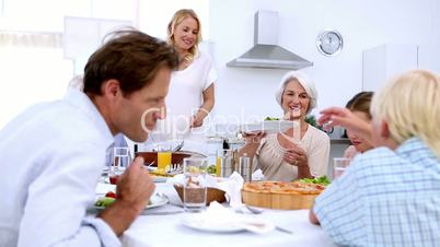 Woman serving salad at dinner