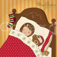 little girl waiting for Santa on Christmas Eve