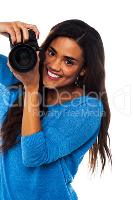 Woman taking a snap, smile please
