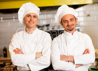 Smart and confident male chefs