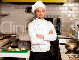 Confident young chef posing