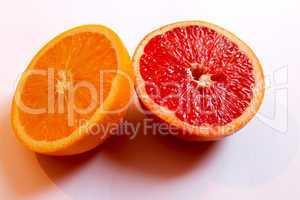 orange and grapefruit divided in half