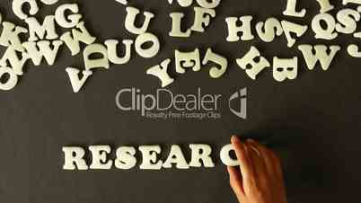 A person spelling Research