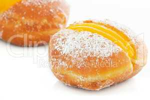 Two Berliner with egg creme over white
