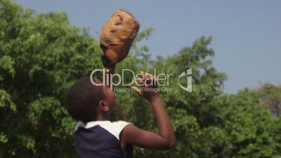 Sports and children portrait, happy african american kid playing baseball