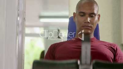 People and fitness, adult hispanic man exercising in gym
