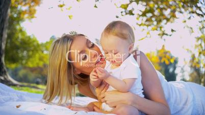 Beautiful Mother and Young Child Outdoors