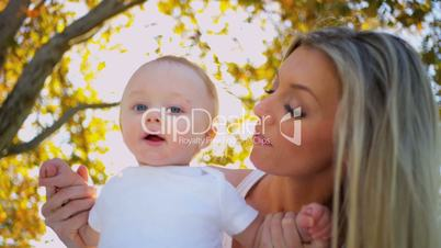 Cute Baby Bouncing in Mothers Arms