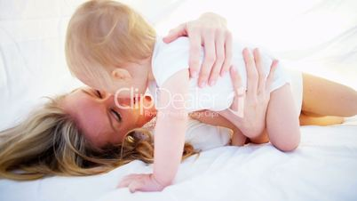 Blonde Mom and Baby Together Indoors