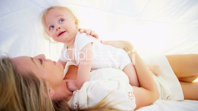 Beautiful Mother and Young Child Indoors