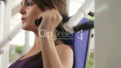 Workout and wellness in fitness club, beautiful young woman exercising