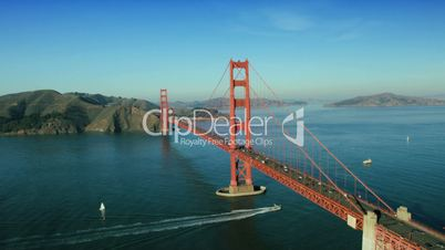 Aerial view of nautical vessels, road traffic, Golden Gate Bridge, USA